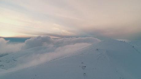 Flying over a full snow-covered mountain range