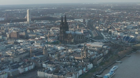 Flying over a German city with a large cathedral