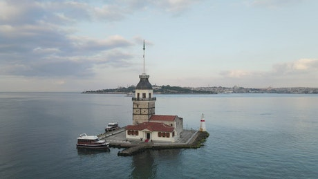 Flying over a lighthouse in the middle of the sea
