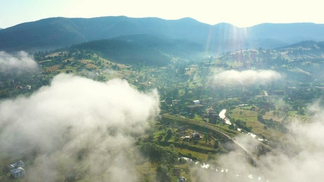Flying over a mountain village in the morning