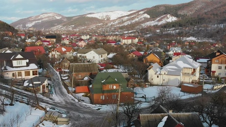 Flying over a small town during the winter