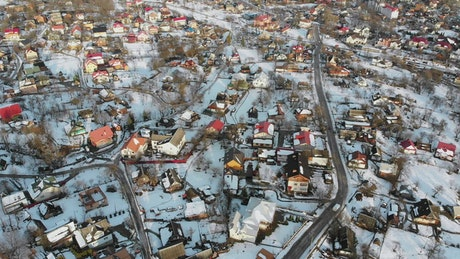 Flying over a small village in the winter