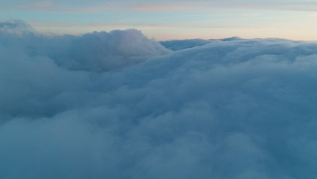Flying over a thick layer of clouds in the sky