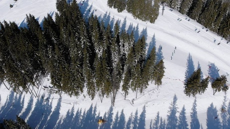Flying over at ski track in the mountain
