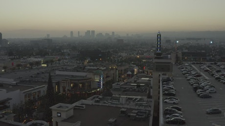 Flying over LA city during a cold sunrise