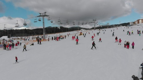 Flying over skiers in the snowy mountain