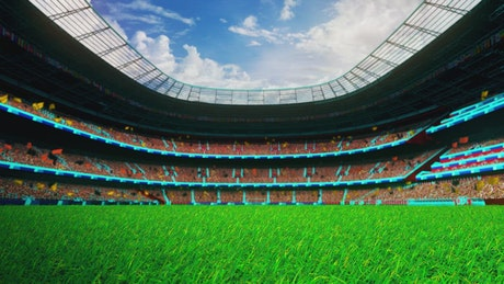 Flying over the grass of a stadium waiting for the game