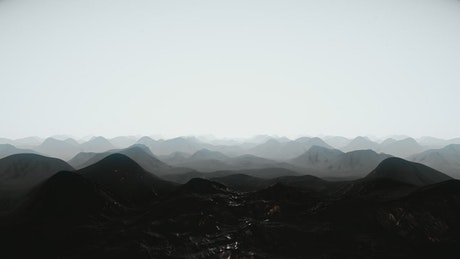 Flying over the silhouettes of mountains of a planet