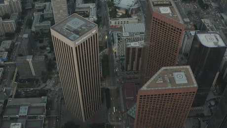 Flying over the skyscrapers and the city of LA