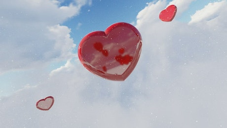 Flying red hearts in the sky