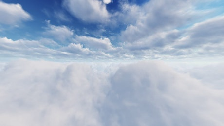 Flying through the clouds in a blue sky