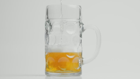 Foaming beer being poured into a glass