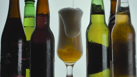 Foamy beer spilling from a glass