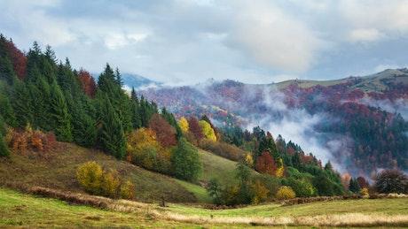 Fog moving among autumn mountains