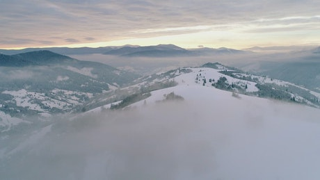 Foggy winter wonderland seen from the air
