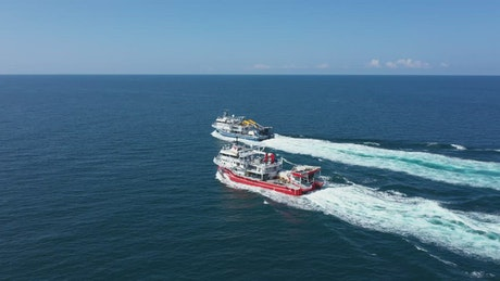 Following two boats across the ocean