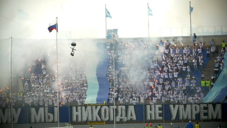Football fans with smoke