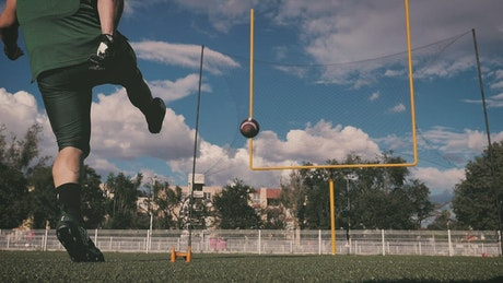 Football player scoring a field goal
