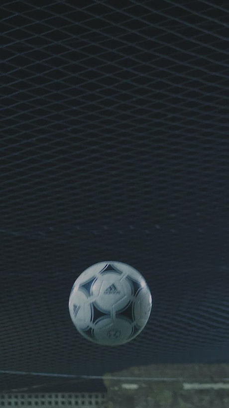 Footballer headbutting the ball