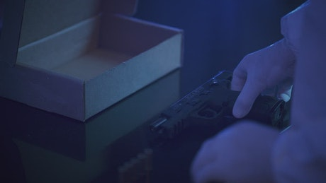 Forensic personnel saving evidence in a box