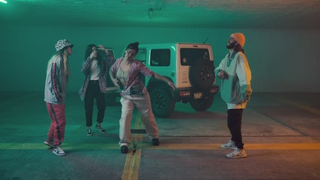 Four hip hop dancers dancing