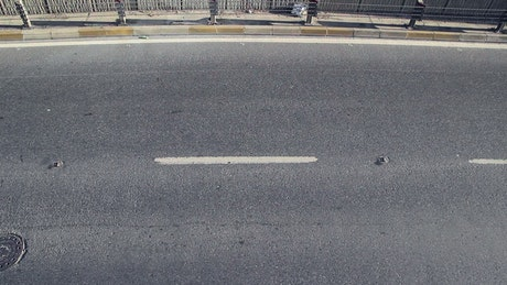 Fragment of road on the street where cars pass
