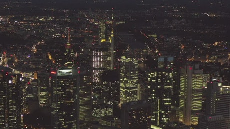Frankfurt at night in the distance, aerial shot