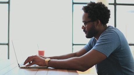 Freelancer typing on their laptop