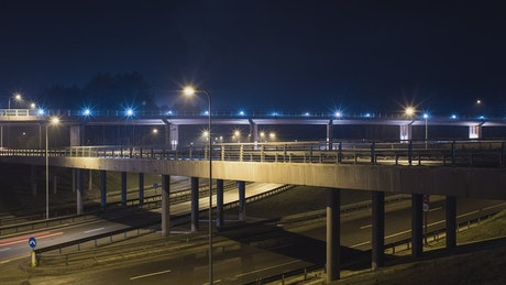 Freeway and  overpass fast traffic at night