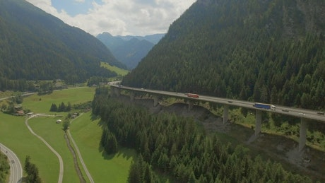 Freeway on a bridge next to a mountainous landscape