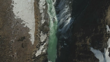 Freezing water breaking over a waterfall