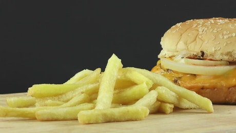 French fries next to a burger