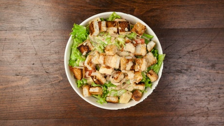Fresh vegetable diet salad on wooden table