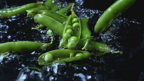 Fresh vegetables falling into water