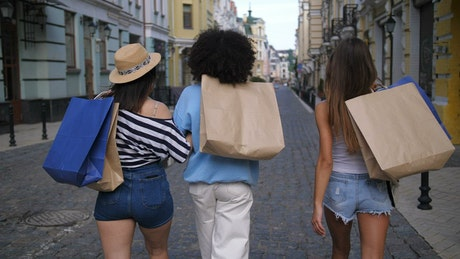 Friends carrying their shopping