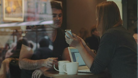Friends chatting in a town coffee shop
