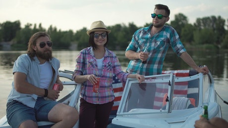 Friends chilling and drinking on a speedboat