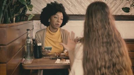 Friends date in a coffee shop