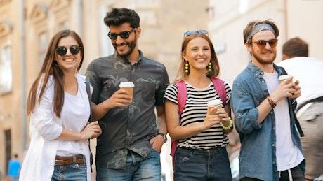 Friends enjoy holiday walk around city