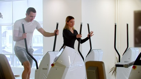 Friends exercising at a modern gym