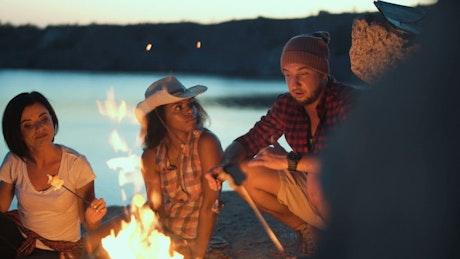 Friends having a conversation in a campfire