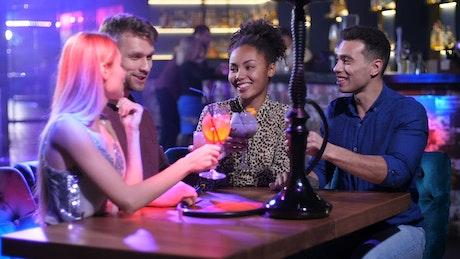Friends having a drink at a nightclub