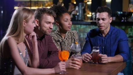 Friends having a quiet drink