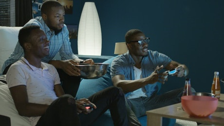 Friends having fun with video games