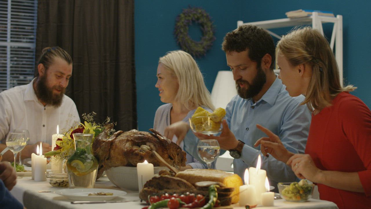 Friends having thanksgiving dinner together - Free Stock Video