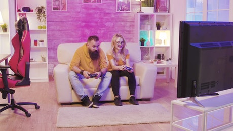 Friends playing a console game