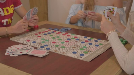 Friends playing a game of Sequence