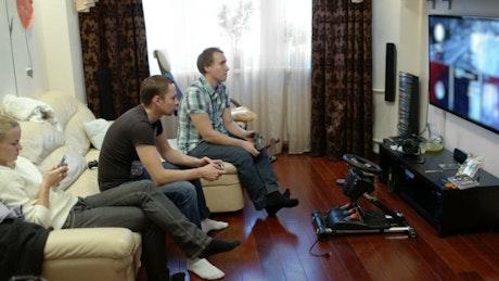 Friends playing a video game splitscreen