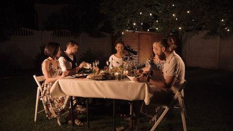 Friends reunion dinner in the garden