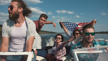 Friends sailing on a speedboat